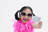 Girl wearing sunglasses holding credit card