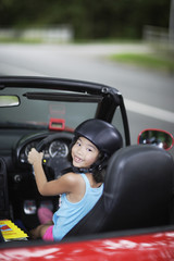 Girl in car wearing helmet