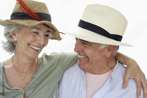 Couple wearing hats smiling at each other