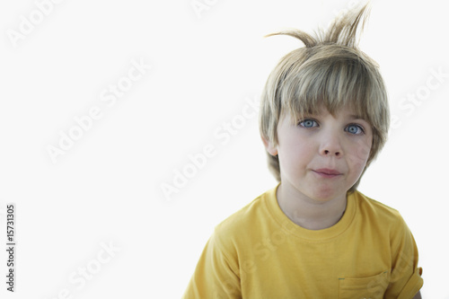 Boy with hair sticking up