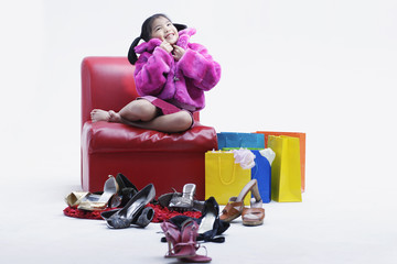Girl with many shoes around her