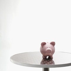 Piggybank sitting on a table