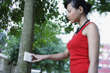Woman looking at wall jack on tree