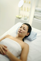 Woman lying on massage table