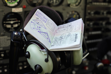 Passport resting on controls in cockpit