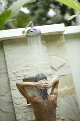 Woman using outdoor shower