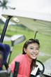 Woman in a golf cart