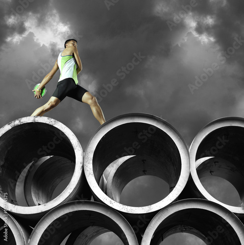 Discus thrower on top of large cylinders