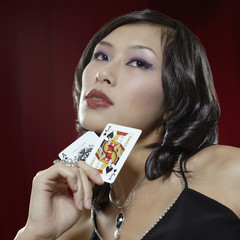 Woman holding Ace and Jack cards