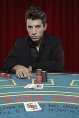 Man at table playing blackjack