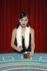 Woman with betting chips at casino table