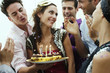 Man giving woman birthday cake
