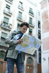 Man holding map outdoors