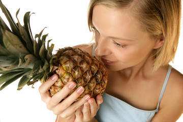 Woman smelling pineapple