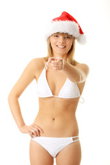 Sensual young woman wearing christmas hat.