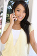 Pretty Asian Woman at Home on Phone