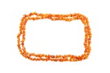 Amber beads double frame isolated on white background