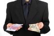 man in suit holding money
