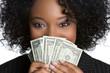 Woman Hiding Behind Money