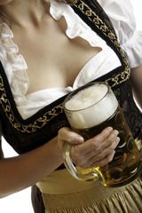Close-up of Bavarian girl holding Oktoberfest beer stein