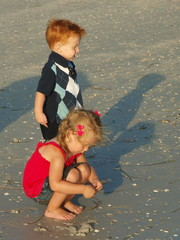 Little boy and girl on the beach alone