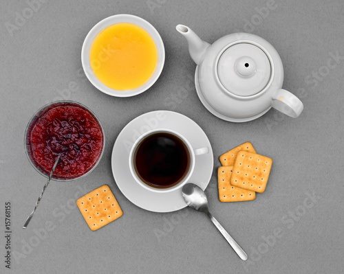 Teapot, cup, honey, jam and crackers (top)