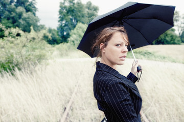 Woman with an Umbrella on rails