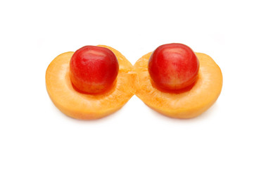 Apricot and sweet cherry on a white background
