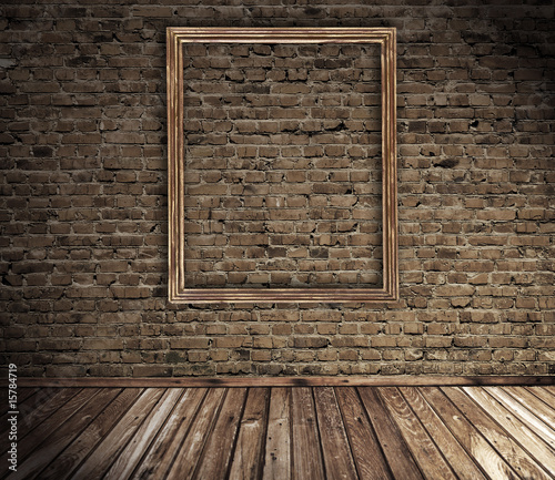 old grunge interior with blank picture frame