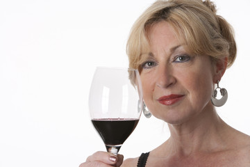 Senior woman with a glass of red wine on white background
