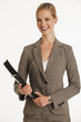 smiling businesswoman holding folder