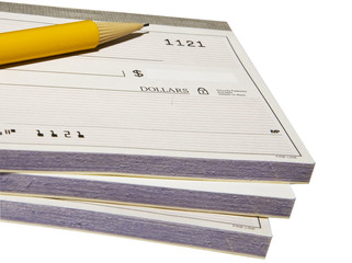 Yellow pencil over a pack of bank checking books isolated