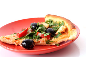 Pizza with olives on the plate