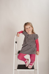 young girl climbing stepladder