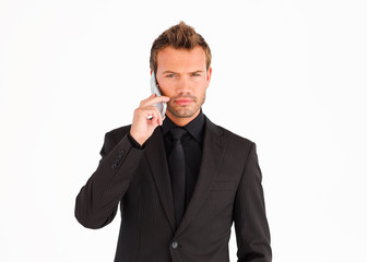 Serious business manager with mobile phone