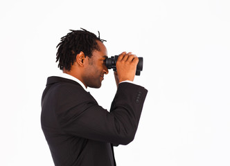 Sidewise closeup of businessman with binoculars