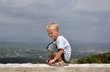 Young boy awaiting bad weather poster