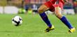 Soccer player running for the ball