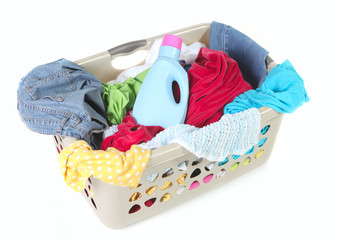 Laundry Basket Full of Dirty Clothes and Softener