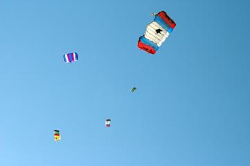 Colours parachutes  in blue sky