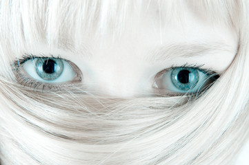 Veiled blond face. Hair and eyes.