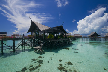 Tropical island resort on crystal clear water.