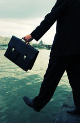 Business men step into the river