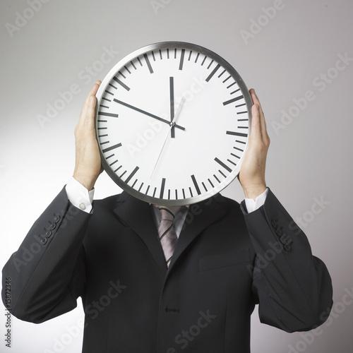 visage d'homme d'affaires horloge