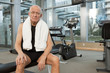 Man in gym with towel