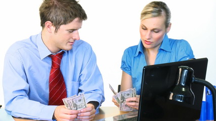 Businessman and businesswoman counting dollars footage