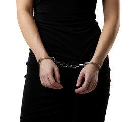 Female body in a black dressed wearing handcuffs