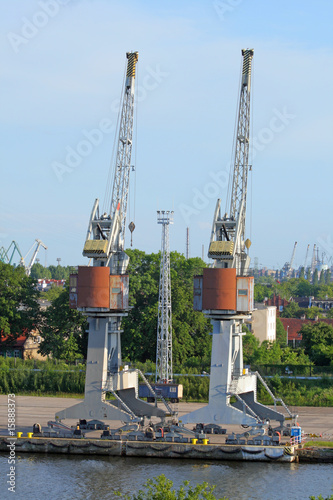 Two big cranes on the dock in a harbour