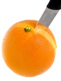 Fresh orange with a inserted knife poster