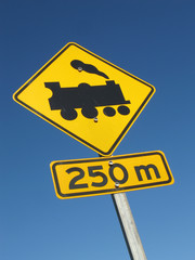 Road sign - train crossing  - 250 m